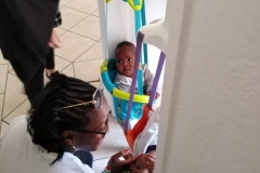 Founder-touching-the-skin-of-a-baby-abandoned-at-the-hospital-by-her-monther